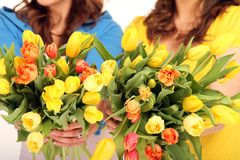 Two girls with flowers. Two girls holding a bouquet stock image