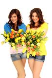Two girls with flowers Royalty Free Stock Photos
