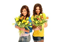 Two girls with flowers Stock Photo