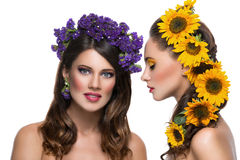 Two girls with flowers in hair Stock Images