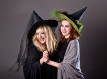 Two girls fool around at a party on Halloween Stock Photos