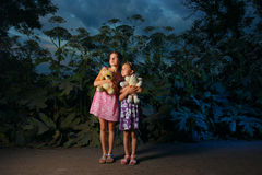Two girls in the  forest at night time Royalty Free Stock Photography