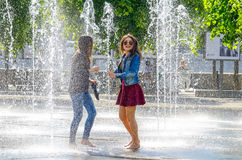 Two girls in fountain. Royalty Free Stock Photography
