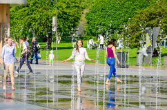 Two girls in fountain. Royalty Free Stock Image