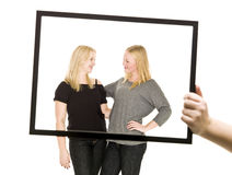 Two girls in a frame Stock Photos