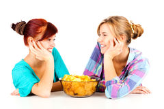 Two girls, friends with chips Stock Images