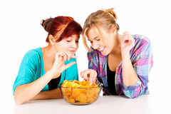 Two girls, friends with chips Royalty Free Stock Photo