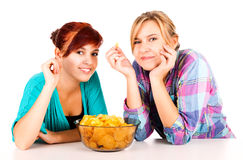 Two girls, friends with chips Royalty Free Stock Photography
