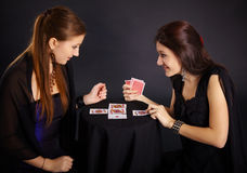 Two girls friends engaged in fortune-telling cards Stock Photography