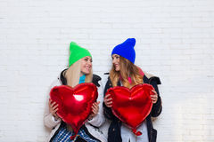 Two Girls Friends Look At Each Other With Red Heart Shape Balloons Valentine Day Stock Photos