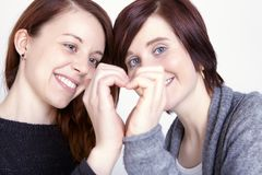 Two girls friends make a heart with hands Royalty Free Stock Image