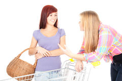 Two girls friends with shopping cart Stock Photography