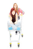 Two girls friends with shopping cart Royalty Free Stock Photography
