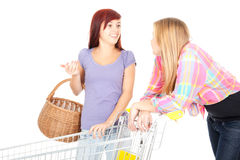 Two girls friends with shopping trolley Stock Images