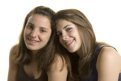 Two girls friends on a studio shot. Two adolescent girls on a studio shot on white background Royalty Free Stock Photos