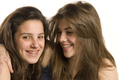 Two girls friends on a studio shot. Two adolescent girls on a studio shot on white background Royalty Free Stock Images