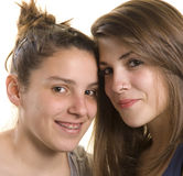 Two girls friends on a studio shot. Two adolescent girls on a studio shot on white background Royalty Free Stock Photo