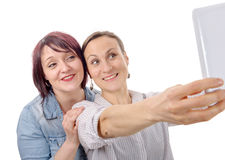 Two girls friends taking selfie with digital tablet Stock Photography