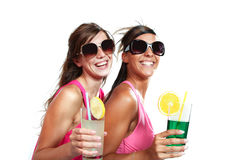 Two girls fun with a drink Royalty Free Stock Images