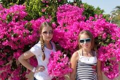 Two girls in garden Stock Photos
