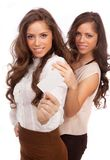 The two girls - GEMINI show a credit card on a whi Royalty Free Stock Image