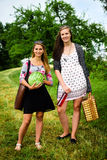 Two girls getting ready for a picnic Royalty Free Stock Photo