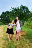 Two girls getting ready for a picnic Royalty Free Stock Photos