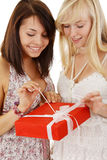 Two girls with gift Stock Image