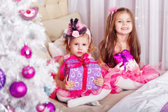 Two girls with gifts for Christmas. Stock Images