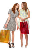 Two girls with gifts after shopping Royalty Free Stock Image