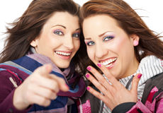 Two girls giggling. Two beautiful girls laughing and pointing at  camera Royalty Free Stock Photo