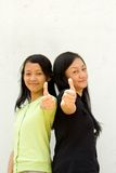 Two girls give thumbs up Royalty Free Stock Photos