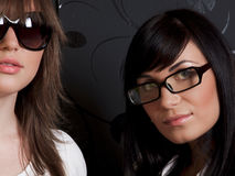 Two girls in glasses. Closeup Stock Photos