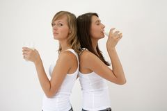 Two girls with glasses of milk Stock Photography
