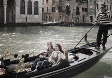 Two girls in gondola on Grand Canal Stock Image