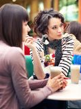 Two girls gossip. And eating icecream stock photos