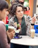 Two girls gossip. And eating icecream royalty free stock images