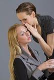 Two girls gossiping Stock Image