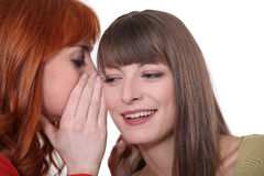 Two girls gossiping Stock Photo