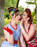Two girls gossiping Royalty Free Stock Images