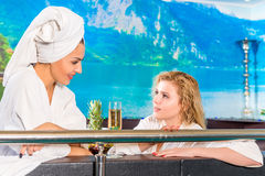 Two girls in gowns communicate after spa Stock Photos