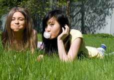 Two girls on grass Stock Photos
