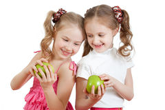 Two girls with green apple healthy food Stock Image