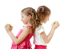 Two girls with green apple healthy food Stock Photo