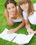Two girls on green grass Royalty Free Stock Photo