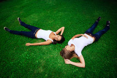 Two girls on green grass Royalty Free Stock Image