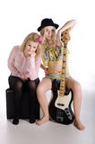 Two girls and a guitar Royalty Free Stock Photo