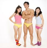 Two Girls and a Guy. Two lucky girls with their fit handsome man Royalty Free Stock Image