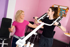 Two girls in the gym Stock Images