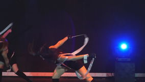 Two girls gymnasts perform acrobatic movements with ribbon stock footage